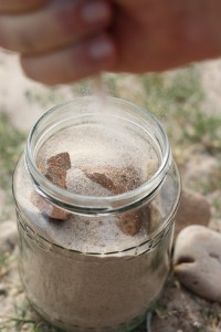 putting sand in the jar